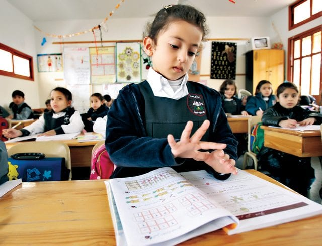 A Palestinian student attends class inside pro-Hamas Dar al-Arkam school in Gaza City February 1, 2006. Palestinian President Mahmoud Abbas will not require Hamas to recognise Israel in order for it to join the next government, a senior Palestinian official said on Wednesday. REUTERS/Ahmed Jadallah